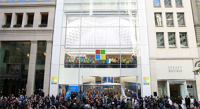 Crowds gather at the new Microsoft Flagship Store on Fifth Ave to celebrate the grand opening on Monday, Oct. 26, 2015, in New York. (Mark VonHolden/Invision for Microsoft/AP Images)